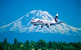 Plane flying past Mount Ranier